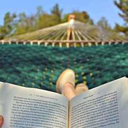 reading a book in a hammock