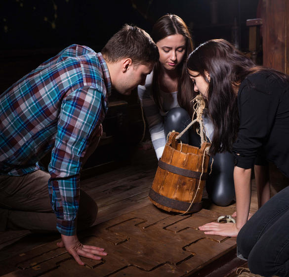 People participating in an escape room activity
