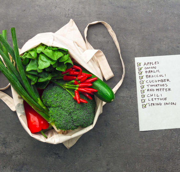 Fresh vegetables and shopping list
