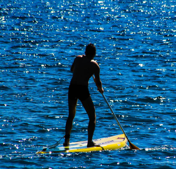 Person paddle boarding
